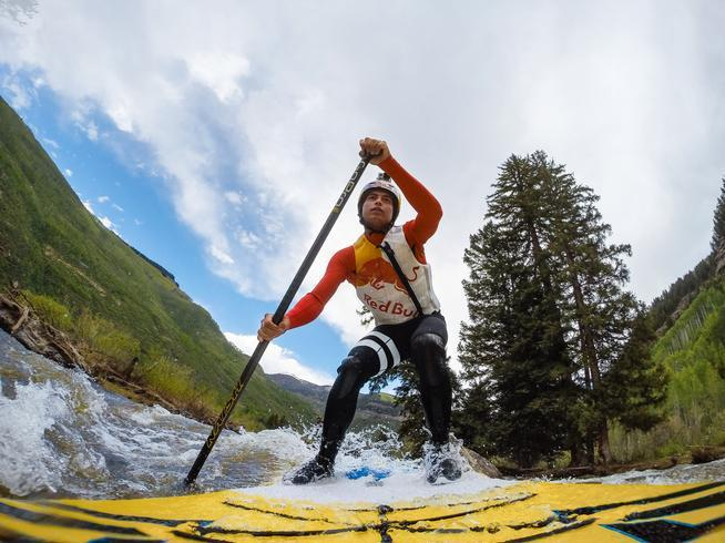 Kai Lenny competes on a stand-up paddleboard at the summer GoProMountain Games in Vail.
