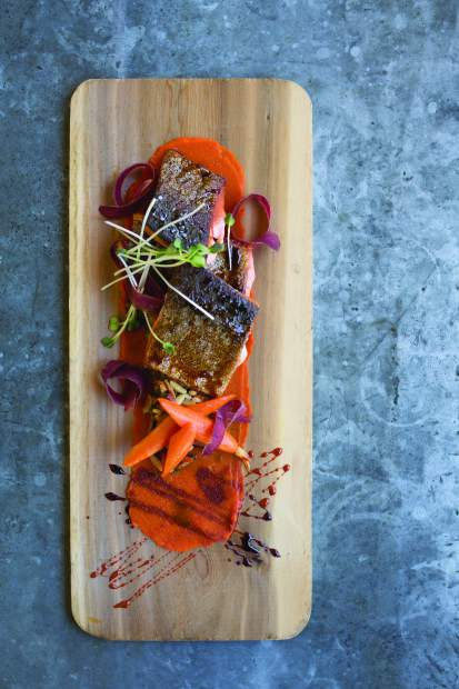 Rocky Mountain ruby red trout comes with a vibrant ginger-carrot puree