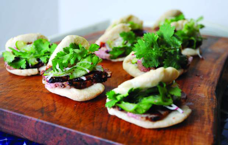 Steamed duck buns are the perfect two-bite food. | FOODsmith | Vail Lifestyle Magazine Summer 2016