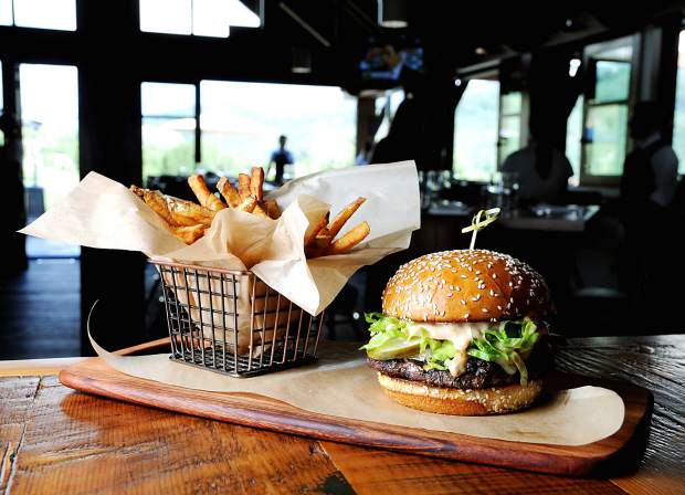The Harvest Burger is made with all-natural beef, special sauce, lettuce, cheese and pickles on a sesame seed bun.